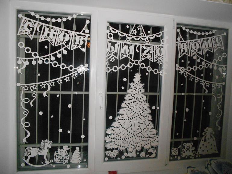 Украшения на окна из бумаги к Новому году 2021. Трафареты и шаблоны новогодних украшений этап 1
